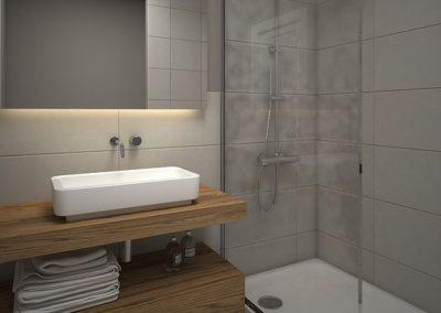 Baño combinado con piso de mosaico antiguo y revestimiento de cerámicas modernas. Mampara de vidrio y mueble de madera